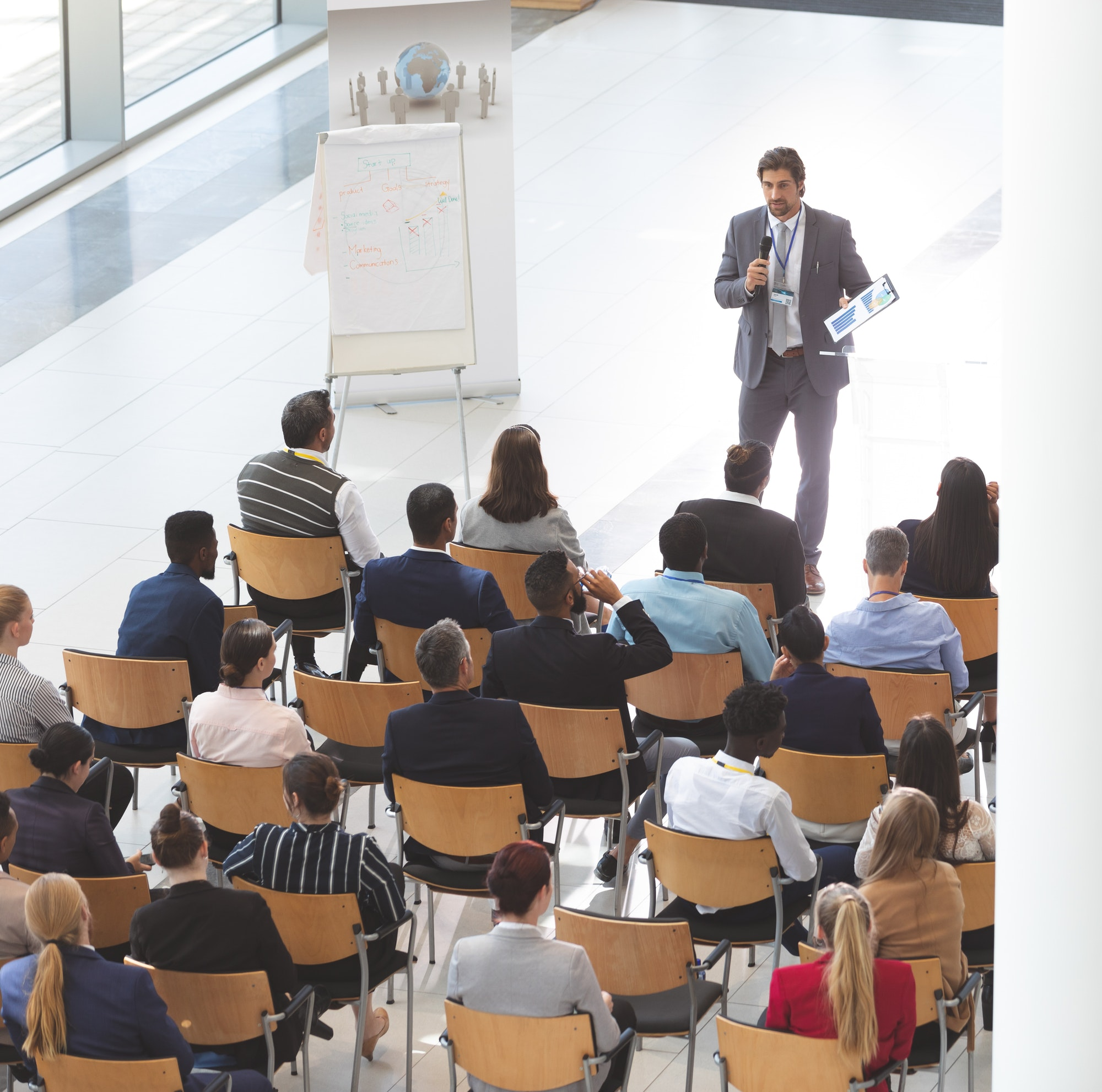 Businessman giving speech at business conference with business people at conference room